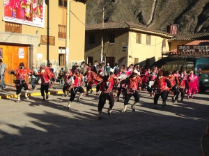 One of the dance groups parading through the plaza.