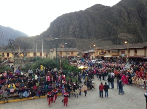 Overview of the plaza during a daytime parade.